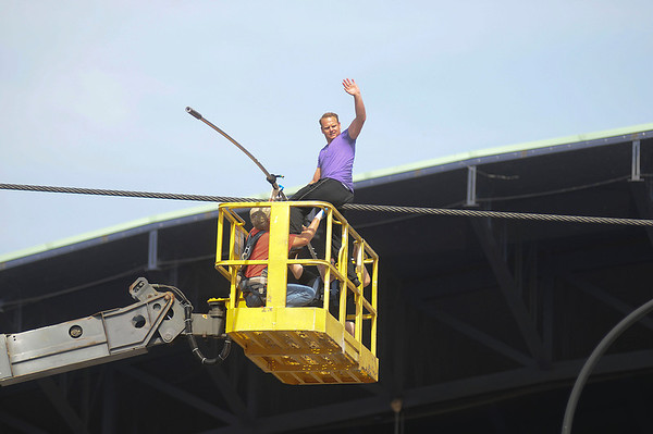 James Neiss/staff photographerNiagara Falls, NY - Daredevil Nik Wallenda waves to a cheering crowd after his afternoon practice walking the high-wire in front of the Seneca Niagara Casino & Hotel.