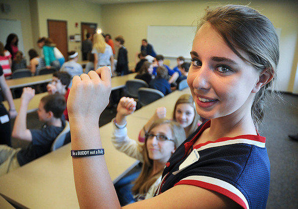 James Neiss/staff photographerLewiston, NY - Be a BUDDY not a BULLY was the theme as more than 200 students in grades 6-9 from the Newfane, North Tonawanda, Royalton-Hartland, Starpoint and Wilson school districts took part in a anti bullying workshop at Niagara University on Thursday. Showing off their wristbands are, from left, Rachel Krawczyk, Rebecca Scutt and Alyssa Privitera.