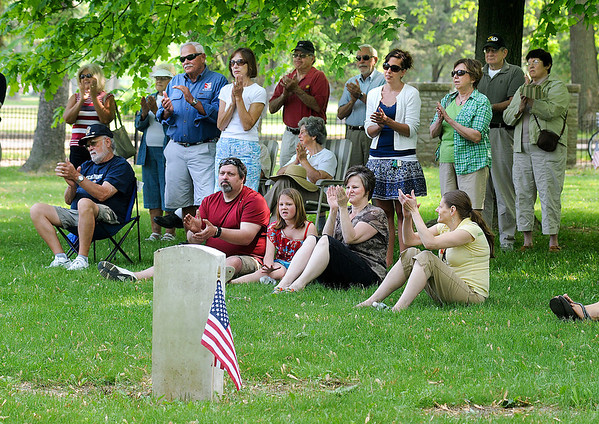 James Neiss/staff photographerYoungstown, NY - Attendees applaud after remarks during Memorial Day services at the War of 1812 Cemetery inside Fort Niagara State Park.