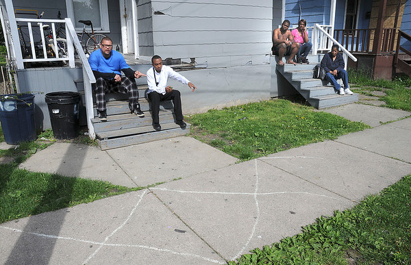 James Neiss/staff photographerNiagara Falls, NY - Niagara Falls residence Ronald Peterson and Aubrey Gainer point to blood splatter in the 400 block of 20th Street after a shooting on Niagara Street in between 19th and 20th Streets Thursday morning.