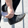 James Neiss/staff photographerNiagara Falls, NY - Nik Wallenda puts on his shoes for his first practice on the high-wire in May.