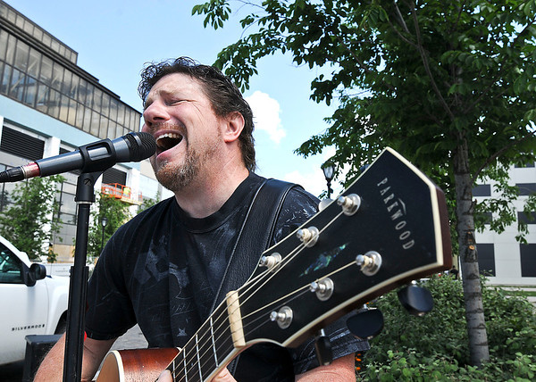 "James Neiss/staff photographerNiagara Falls, NY - Tom Bender is passionate about his music and is the featured ""Tunes @ Noon"" musician every Thursday this summer on Old Falls Street. Featured musicians will be playing Old Falls street every day all summer long from Noon to 3 p.m."