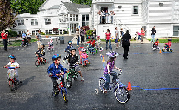 James Neiss/staff photographerYoungstown, NY - Youngsters in The Children's House morning program at the First Presbyterian Church in Youngstown ride their trikes and bikes to raise money for the St. Jude Children's Research Hospital on Wednesday.