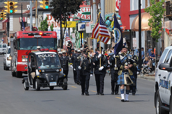 James Neiss/staff photographerNiagara Falls, NY - Niagara Falls Police and Firefighters lead off the Memorial Day weekend parade on Pine Avenue.