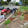 James Neiss/staff photographerSanborn, NY - Margo and Paul Beecher took advantage of the nice weekend weather to spruce up their yard along Town Line Road on Saturday.