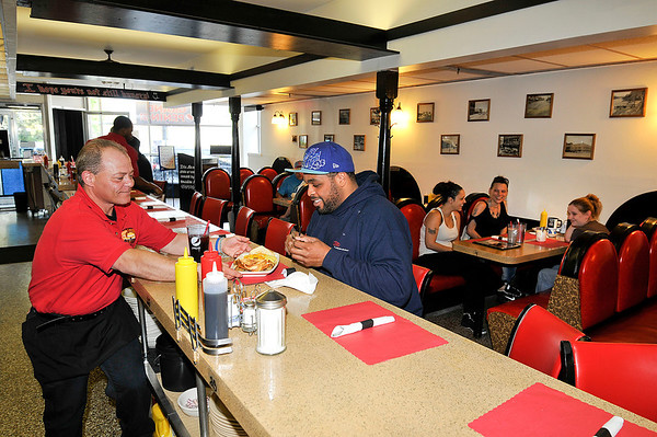 James Neiss/staff photographerNiagara Falls, NY - Head server Mark Rossi serves up a western omelet to Keenan Kitchen of Niagara Falls at the Over Dose Cafe on Main Street.