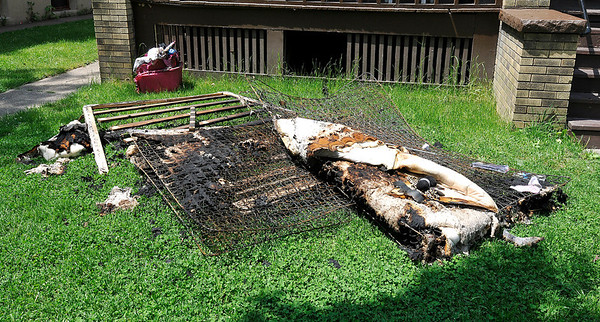 James Neiss/staff photographerNiagara Falls, NY - Burned bedding was on the front lawn after a fire at 432 23rd Street.