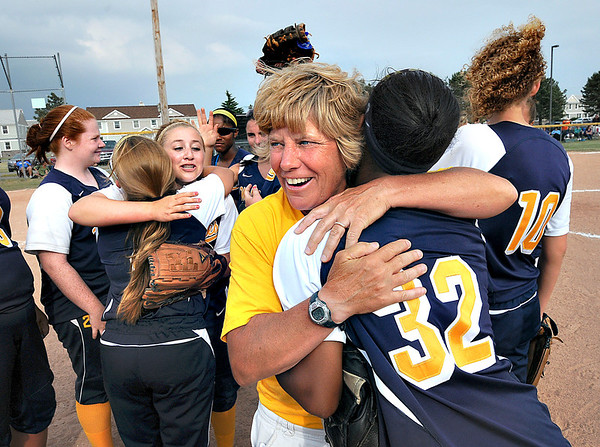 James Neiss/staff photographerNiagara Falls, NY - Niagara Falls Girls Softball Coach Beth Bullock gives a hug to player #32 Zaire Peterson during winning celebrations after beating Williamsville North in the Class AA girls softball semifinal.
