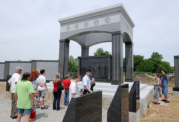 James Neiss/staff photographerNiagara Falls, NY - Family members of those who gave the ultimate sacrifice for their country were the first to see the new Niagara Falls Veterans Memorial after Memorial Day services at Hyde Park on Saturday.