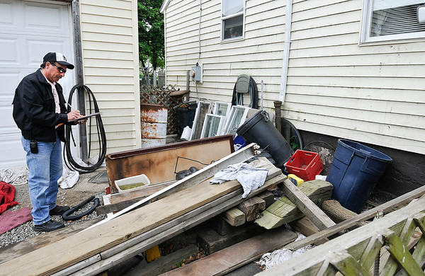 James Neiss/staff photographerNiagara Falls, NY - Pat Corsaro, Clean Neighborhood Inspector, writes up a home with a run down yard on Simmons Avenue before issuing an order of cleanup for the owner.