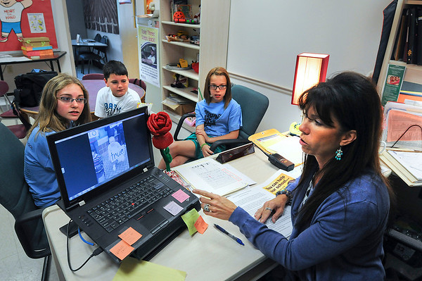 James Neiss/staff photographerNiagara Falls, NY - Cataract Elementary School Counselor Molly Kurek and 6th grade students are entering a video in hopes of winning $20,000 for an outdoor classroom. Previewing the video are, from left, Allison White, Zackery Law, Chloe' Newell and School Counselor Molly Kurek.