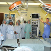 "James Neiss/staff photographerNiagara Falls, NY - Operating Room Technician Kim Reeves shows off the OR VIP students. Niagara Street Elementary students from Mrs. Peters 5th grade got a chance to visit the da Vinci robotic operating room at Niagara Falls Memorial Medical after a classmate named the robot ""SAL,""  which stands for Save A Life."