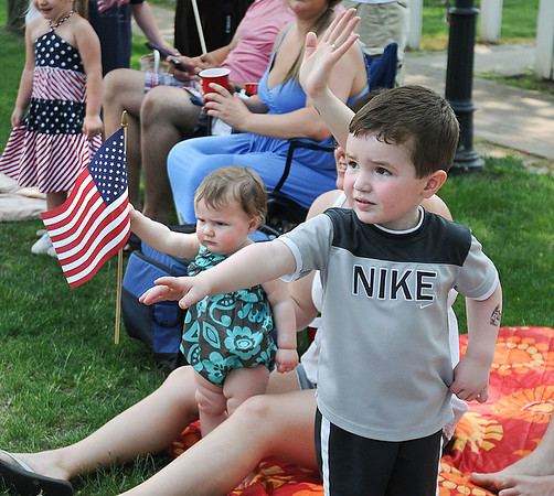 James Neiss/staff photographerLewiston, NY - Abbigail Deering, 11 months, and her brother Andrew, 2, wave at the passing Memorial Day parade in Lewiston on Center Street.