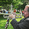 James Neiss/staff photographerYoungstown, NY - Trumpeter Lew Custode of Niagara Falls plays Taps at the conclusion of Memorial Day Services at the War of 1812 Cemetery. The event was sponsored by Lake Ontario VFW Post #313 in Youngstown.