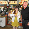 James Neiss/staff photographerWheatfield, NY - Robert Burns, owner of Tim Hortons at 2248 Niagara Road, presents a check for $1000 to the Muscular Dystrophy Association. Accepting the check is Lauren Bonilla, fundraising coordinator with the MDA.