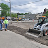 James Neiss/staff photographerLewiston, NY - Town of Lewiston machine equipment operators, from left, Gary Ferenc, Mike Townsend and Dave Catlin put the finishing touches on a parking lot at the Lewiston Fire Company No. 1 on North 6th Street, after the asphalt was removed for an expansion project, they said.