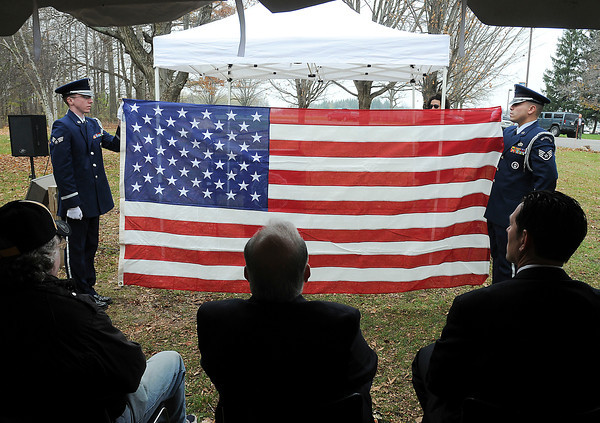 James Neiss/staff photographerSanborn, NY - Members of the Niagara Falls Air Force Base Honor Guard SRA Ryan Lanighan, left, and SSGT Edwin Castro, perform show of the full American flag during a flag folding demonstration during the Veterans Day Ceremony at Niagara County Community College.