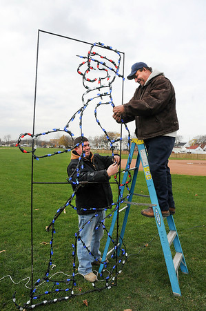 James Neiss/staff photographerNiagara Falls, NY - Niagara Falls City Trades workers Phil Harvey and electrician Tony Paretto, work on light displays at Hyde Park. The Holiday Lights of Niagara Trail opens on November 21.