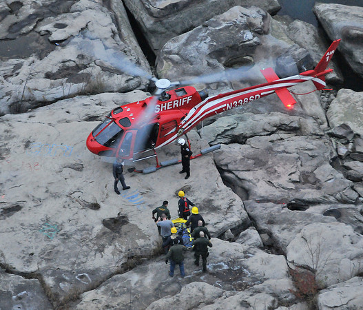 James Neiss/staff photographerNiagara Falls, NY - The Niagara Falls Fire Department teamed up with New York State Parks Police and the Erie County Sheriff Department helicopter to rescue a woman that was found in the Niagara River clinging to rocks, down in the Niagara Gorge at Whirlpool State Park.