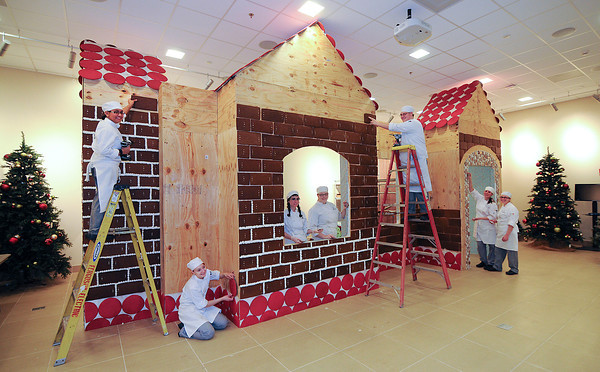 "James Neiss/staff photographerNiagara Falls, NY - Student at the Niagara County Community College Niagara Falls Culinary Institue show off some of the work they've done constructing a Gingerbread House that will be Santa's Workshop this holiday season. Students from left, are, Joy Letson, Corin Gildner, Alexis Kerr, Elizabeth Dyrbala, Jeff Cross, Kristin Pascolini and Hanna Winter. Press ReleaseNCCC to host Santa's Workshop at Culinary InstituteSANBORN – Niagara County Community College in conjunction with the College Association of NCCC will host Santa's Workshop weekends at the College's new Niagara Falls Culinary Institute beginning this Saturday, December 1 through December 24.Santa's Workshop will feature visits and photos with Santa Claus in the Gingerbread House. The festivities will also feature story reading, cookie decorating for children, holiday movies, chef and horticulture demonstrations, an ice carving demonstration and the American Culinary Federation's gingerbread house decorating competition on December 15. The hours for Santa's Workshop are:Fridays (December 7, 14, 21) from 6:00-9:00 PMSaturdays (December 1, 8, 15, 22) from 1:00-8:00 PMSundays (December 2, 9, 16, 23) from 1:00-5:00 PMMonday, December 24 from Noon-3:00 PMThe full list of activities can be found online at  <a href=""http://www.nfculinary.org"">http://www.nfculinary.org</a>"