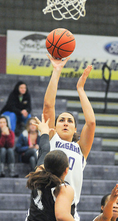 James Neiss/staff photographerNiagara Falls, NY - Niagara University Purple Eagles #30 Lauren Gatto puts the ball up during basketball game action against the St. Bonaventure Bonnies.