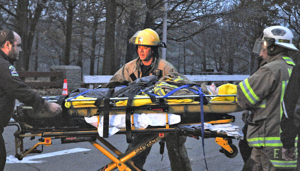 James Neiss/staff photographerNiagara Falls, NY - First responders put a woman in a waiting ambulance after she was rescued from the chilly waters of the Niagara River. The victim was found in the water clinging to a rock in the Niagara Gorge at Whirlpool State Park.