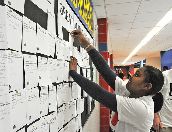 James Neiss/staff photographerNiagara Falls, NY - Niagara Falls High School student Sha' Nesha Allen posts wishes made for people to stop smoking during the 2nd Annual Niagara Falls High School Great American Smoke Out event at the school.
