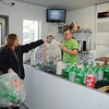 James Neiss/staff photographerNiagara Falls, NY - Karla Landers of Niagara Falls hands off bags or returnables to Jonathan Miller, manager at ECO Centers, a bottle and can redemption center along side car wash bays at the former Rainbow Car Wash on Niagara Falls Boulevard. In an effort to diversify, the owners of the 3 Rainbow Car Wash's in Niagara Falls have added a bottle and can redemption center to the Niagara Falls Boulevard and 11th street sites, with plans to do the same at the Hyde Park Boulevard location. All 3 sites will be rebranded ECO Centers.
