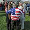 James Neiss/staff photographerNiagara Falls, NY - Patriotic Army veteran James Joyce, center, hugs his wife Cindy-Lou, left, and his son Jonathan, a decorated Army veteran, during the 2012 Veterans Day observance at Hyde Park.