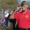 James Neiss/staff photographerNiagara Falls, NY - Doug Wooley, commandant of the Marine Corp. League LT. John P. Bobo Detachment, left, plays Taps after the placement of the wreaths during the 2012 Niagara Falls Veterans Day observance at Hyde Park.