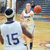 James Neiss/staff photographerNiagara Falls, NY - Niagara University Purple Eagles #10 Kelly Van Leeuwen passes the ball to #15 Kayla Stroman during basketball game action against the St. Bonaventure Bonnies.