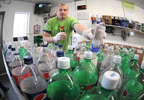 James Neiss/staff photographerNiagara Falls, NY - Jonathan Miller, manager at ECO Centers Bottle & Can Redemption Center and Car Wash, sorts a load. The rebranded business takes up 2 of the old car wash bays at the former Rainbow Car Wash on Niagara Falls Boulevard.