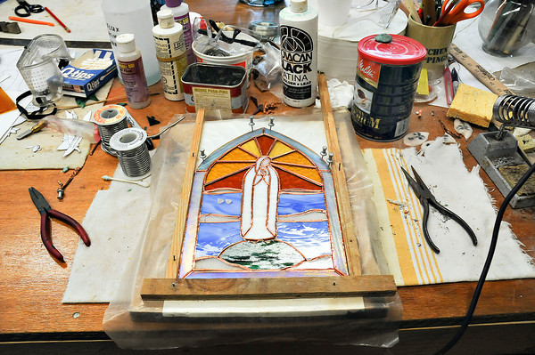 James Neiss/staff photographerNiagara Falls, NY - Our Lady of Fatima Director Father Julio Ciavaglia wears many hats as the Director including Stained Glass Multi Media Artist, having a hands on approach to repairing the shrines stained glass and creating pieces for sale.