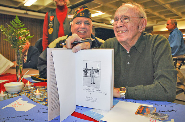 "James Neiss/staff photographerNiagara Falls, NY - Theodore ""Dutch"" Van Kirk, the last living crewman and navigator on the Enola Gay, the Silverplate B-29 that dropped the atomic bomb on Hiroshima, shows off a signed book during the 2012 Veteran's Day Dinner at Lewiston Porter High School. The dinner was hosted by the Lewiston-Porter Air Force Junior ROTC.Lake Ontario VFW Post 313 Commander Ralph Borelli, left, joined Van Kirk for a conversation."
