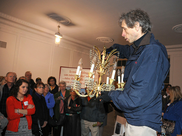 James Neiss/staff photographerNiagara Falls, NY - Hotel Niagara owner Harry Stinson shows off a chandelier he's having restored for the lobby of the hotel. Stinson gave Members of Preservation Buffalo Niagara a tour of the hotel on Monday.