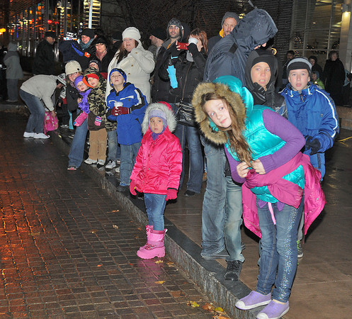 James Neiss/staff photographerNiagara Falls, NY - Children strain to get a good look as Santa arrives by fire truck for the lighting of Old Falls Street. Old Falls Street, USA, hung more than 100,000 lights for the holidays.