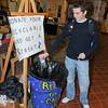 James Neiss/staff photographerNiagara Falls, NY -  Niagara University Sports Management major Matt Downen, 18, gets in the school spirit by recycling a bottle at the Recycle for a Cause booth at the Gallagher Center, where other booths were set up to educate attendees on how to live more environmentally friendly on America Recycles Day.