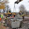 James Neiss/staff photographerNiagara Falls, NY - Accadia Contracting workers install a storm drain filtration system on the corner of Whirlpool Street and Chasm Avenue that's tied into drains along the Lewiston Road construction project.