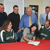 "James Neiss/staff photographerNiagara Falls, NY - Francesca ""Frankie"" Costanzo signs a letter of Intent to play softball at Mercyhurst University. Joining her in back, from left, are coach Jeff Covel, Athletic Director Larry Puzan, Principal Robert Di Francesco and coach Mike Fitzgerald. Joining Frankie, center, are her mother Kathy, left and her father Robert, right."