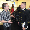 James Neiss/staff photographerNiagara Falls, NY - U.S. Naval Academy Midshipman Stephen Rodriguez chats with Jude Holka, 17, a member of the St. Leo's Church Youth Group. Rodrigues joined the group for a talk about life at the Annapolis Naval Academy, before joining them for a few games of Bowling at the Rapids Bowling Alley.