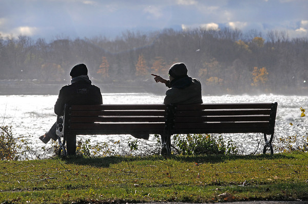 James Neiss/staff photographerNiagara Falls, NY - Tourists Shan Raza, left and Adnan Khan, both from Pakistan, take in the sites from Goat Island during a visit to Niagara Falls State Park on Saturday.