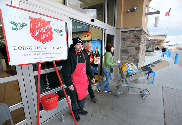 James Neiss/staff photographerNiagara Falls, NY - Black Friday shoppers at the Niagara Falls Walmart pass by Salvation Army Bell Ringer Peter Raverinni of Niagara Falls as he rings his bell for donations.