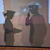 James Neiss/staff photographerNiagara Falls, NY - Niagara Falls Air Force Base Honor Guard member SRA Ryan Lanighan, right, gives a final salute to the American flag in shadow as he and SRA Latosha Cain, left, perform a Folding of the Flag ceremony during the Take a Vet to School Day Program at Harry F. Abate Elementary School on November 14.