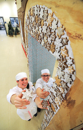 James Neiss/staff photographerNiagara Falls, NY - Hanna Winter and Kristin Pascolini, students at the Niagara County Community College Niagara Falls Culinary Institue, show off some of the work done constructing a Gingerbread House that will be Santa's Workshop this holiday season.