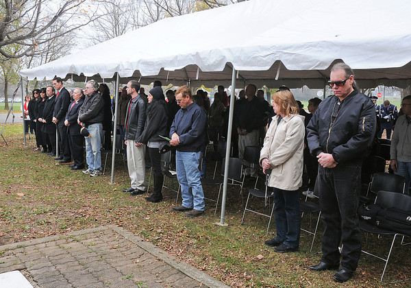 James Neiss/staff photographerSanborn, NY - Attendees bow their heads in prayer during the Veterans Day Ceremony at Niagara County Community College on Friday.