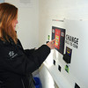 James Neiss/staff photographerNiagara Falls, NY - ECO Centers patron Karla Landers of Niagara Falls cashes in her bottle return ticket at the onsite atm.