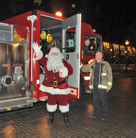 James Neiss/staff photographerNiagara Falls, NY - Santa arrives on a Niagara Falls fire truck for the lighting of Old Falls Street. Old Falls Street, USA, hung more than 100,000 lights for the holidays.