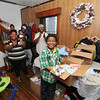 James Neiss/staff photographerNiagara Falls, NY - Christopher Quiros 9, gets a round of applause from his family for spearheading a drive to collect goods for the hurricane victims. Family members include, Arialle Quiros, his mother, Tyquan, 7 and Kadsen, 6, his brothers, Christopher Dillard in white and his stepfather Edward Bloom with baby sister Gabriel Bloom, 8 mos.