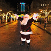 James Neiss/staff photographerNiagara Falls, NY - Santa Claus waves to onlookers and poses for photos after the Old Falls Street, USA, street lighting ceremony.