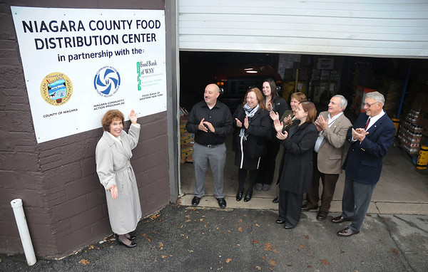 James Neiss/staff photographerNiagara Falls, NY - Guests applaud Suzanne Shears, executive director of the Niagara Community Action Program after a new sign was unveiled at the Niagara County Food Distribution Center on Pine Avenue. The CAP, Niagara County and the Food Bank of Western New York have been long-time partners in providing foods to 40 area outlets.